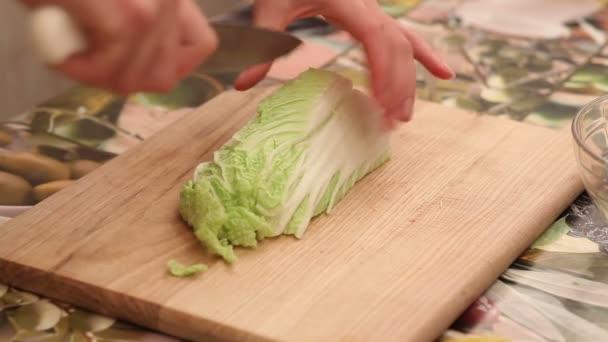 Preparation of salad on the kitchen
