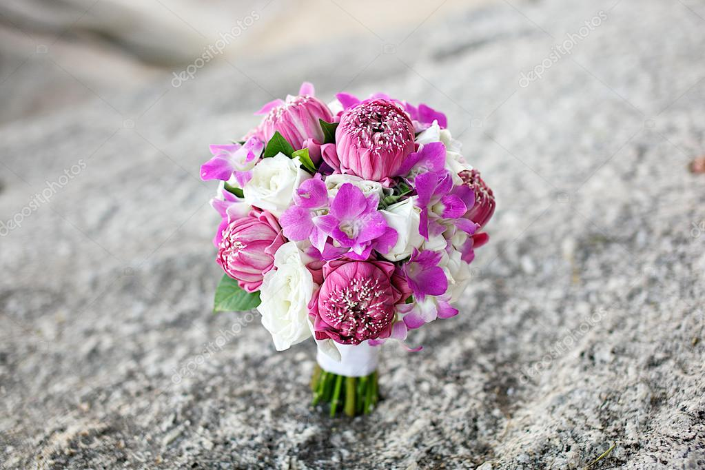 Lotus flower wedding bouquet on the rock — Stock Photo ...