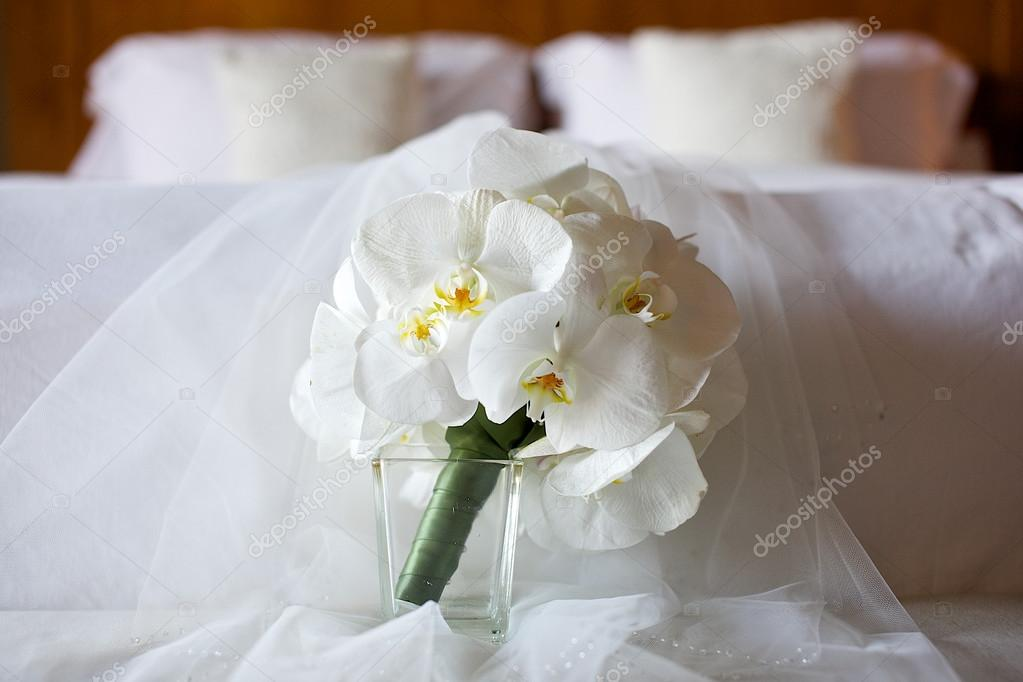 White orchid wedding bouquet on the bed stock photo white orchid wedding bouquet on the bed stock photo mightylinksfo