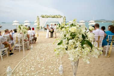 soft focus of beautiful flower decoration in the beach wedding c