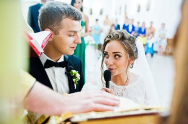 Wedding couple give an oath in church