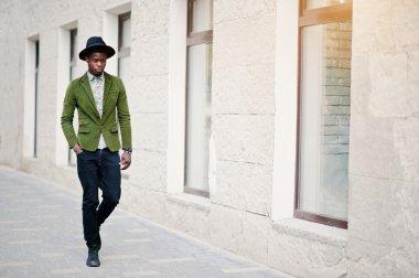 Fashion portrait of black african american man on green velvet j