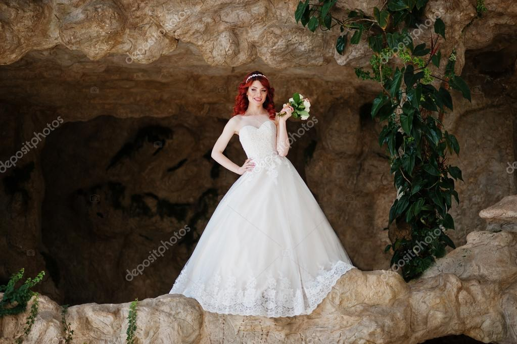 Wedding Pos | Charming Red Haired Bride Model With Wedding Bouquet At Hand Pos