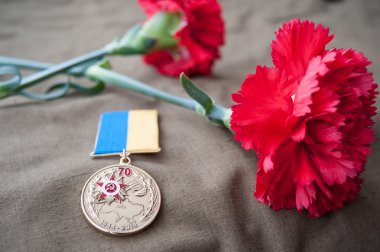 Medal 70 Years of Liberation of Ukraine from the Nazis and two red carnations