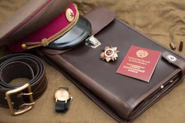 Still life with vintage objects dedicated to Victory Day. Order of the patriotic war 1st class. May 9