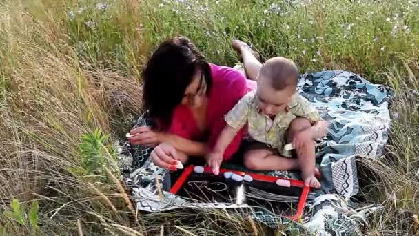 happy mother and son playing outdoors