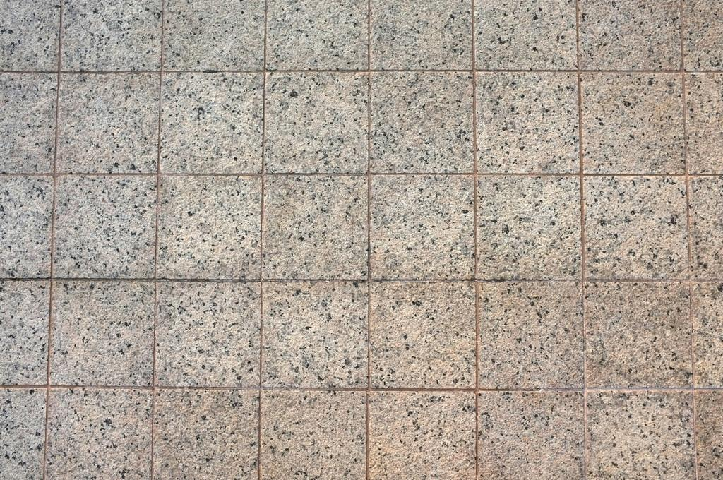 Background e texture di granito e piastrelle di cemento muro