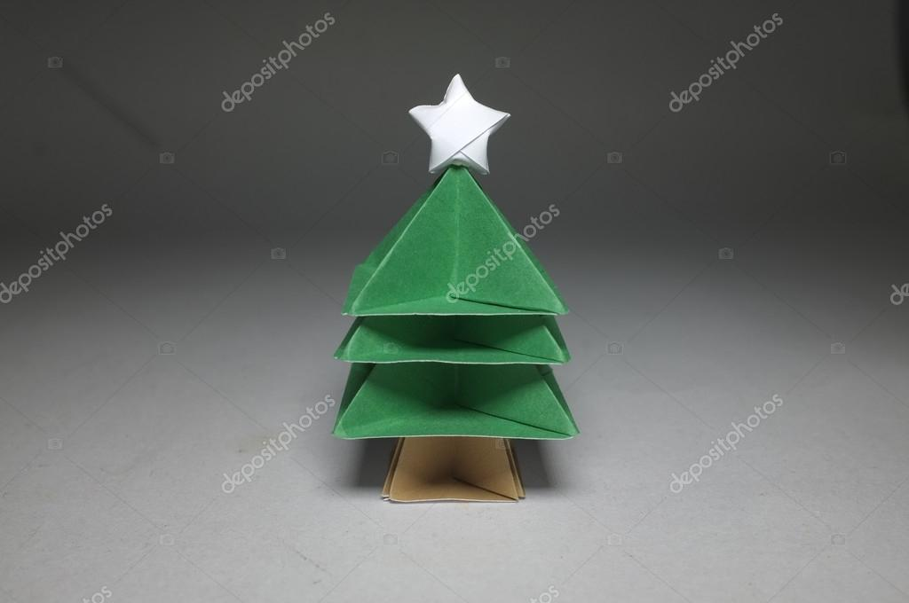 Origami In Shape Of Christmas Tree With Star On Top Stock Photo