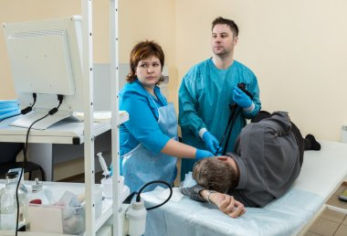The patient is examined by a doctor in the room endoscopist