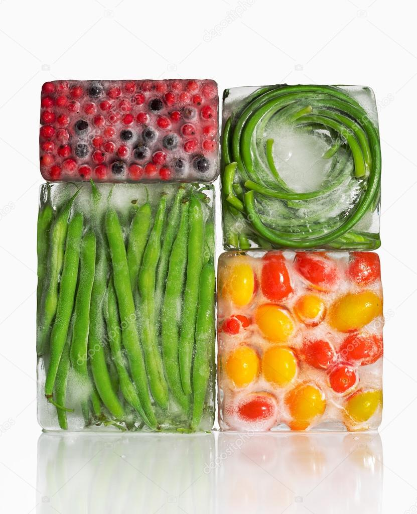 frozen vegetables and berries in ice cubes