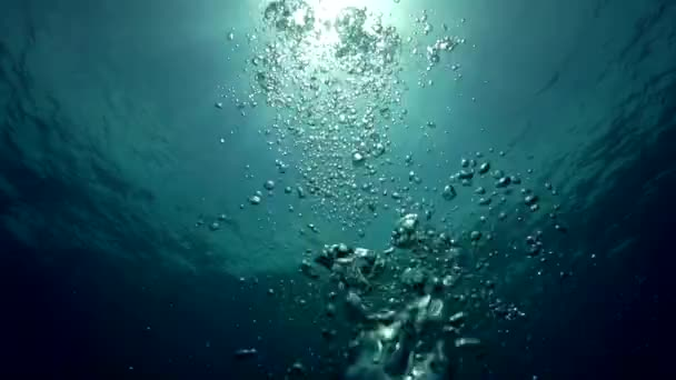 Slow motion shot of Air bubbles under water