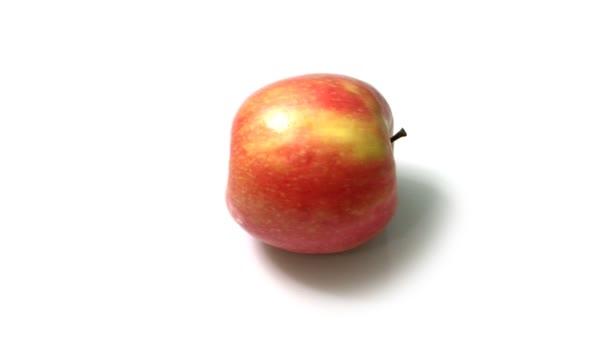 Rotující červené zralé jablko