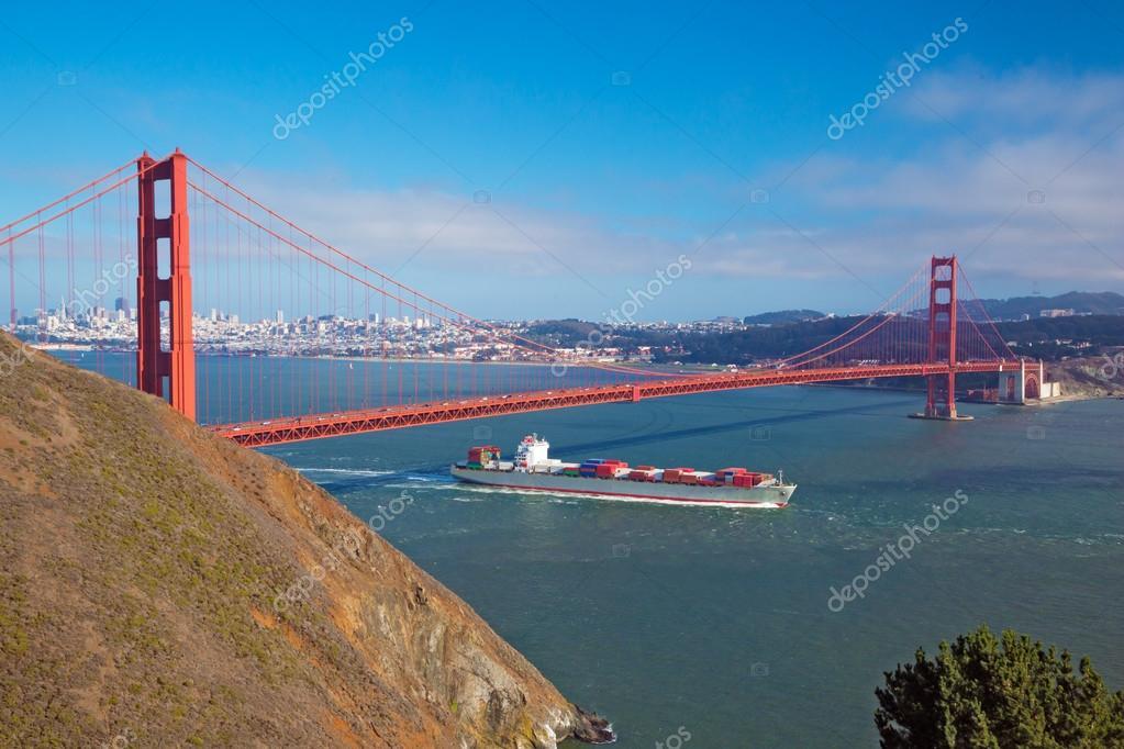 Golden Gate & cargo ship passing below