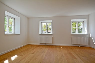 Living room in an old building - Apartment with wooden windows and parquet flooring after renovation