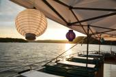 Fotografie Chain of lights with paper lanterns for a summer party on a boat