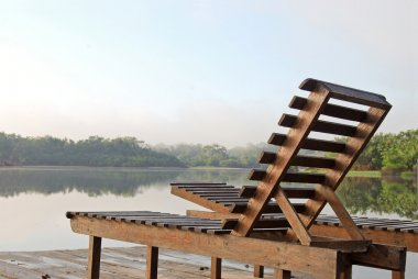 Deckchairs on a lookout point in the Amazon rainforest, Brazil