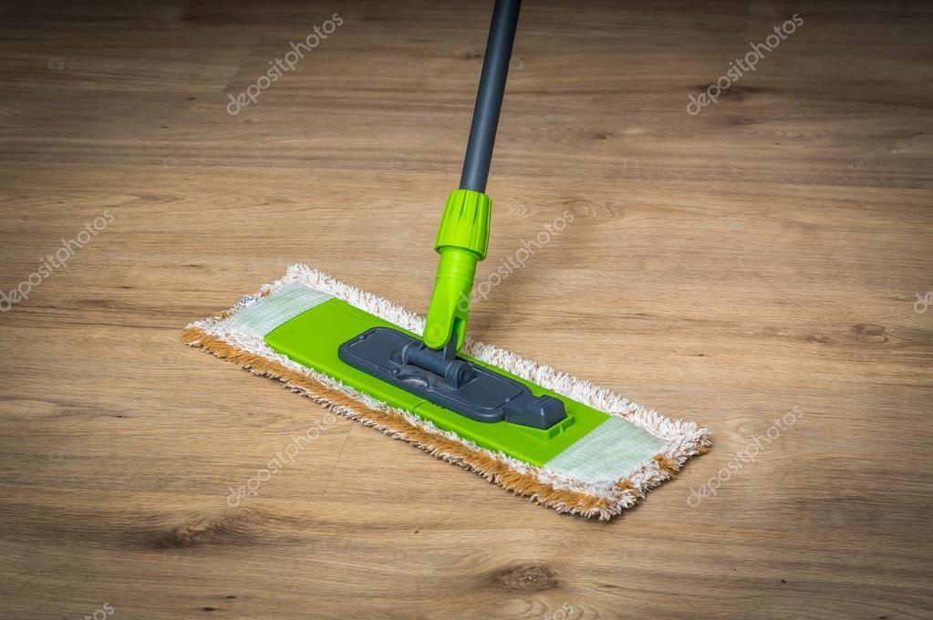 Woman With Mop Mopping Wooden Laminate Floor Stock Photo