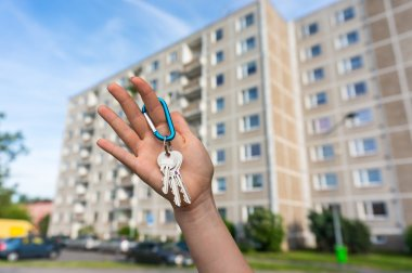 Real estate agent giving flat keys to a new property owner