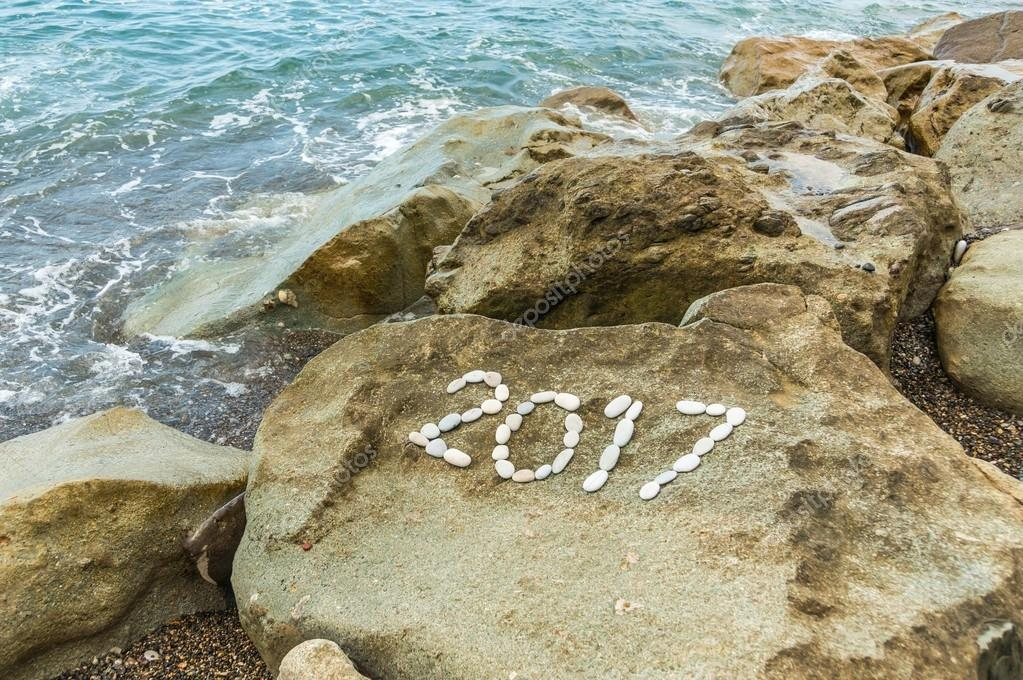 Number 2017 on the rocks off the coast