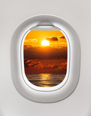 Looking out the window of a plane to the Black sea and sunset