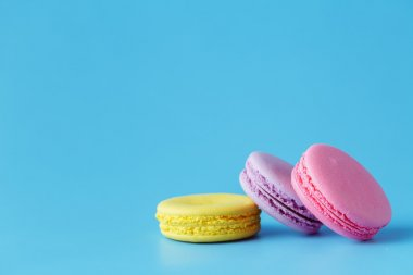 macarons over blue background with room for copy space