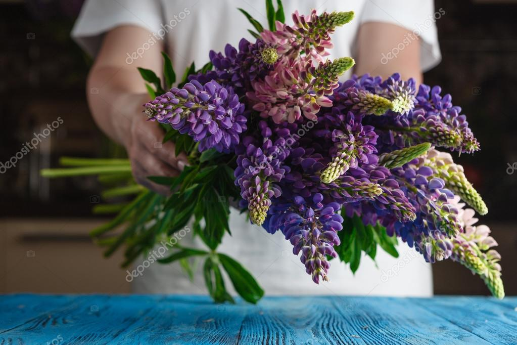 Female hold Bouquet of summer flowers