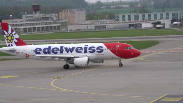 Edelweiss airplane taxiing to runway at Zurich airport. Movie shot May 1st, 2021, Kloten, Switzerland.