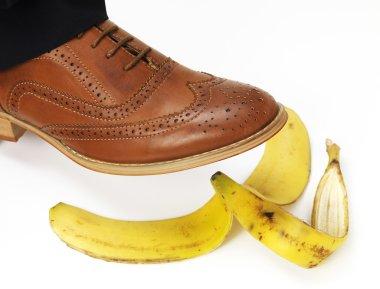 Brown brogue slipping on a banana stock vector