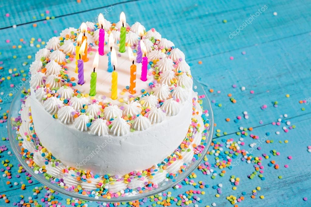 Colorful Birthday Cake with Candles Stock Photo juliannafunk