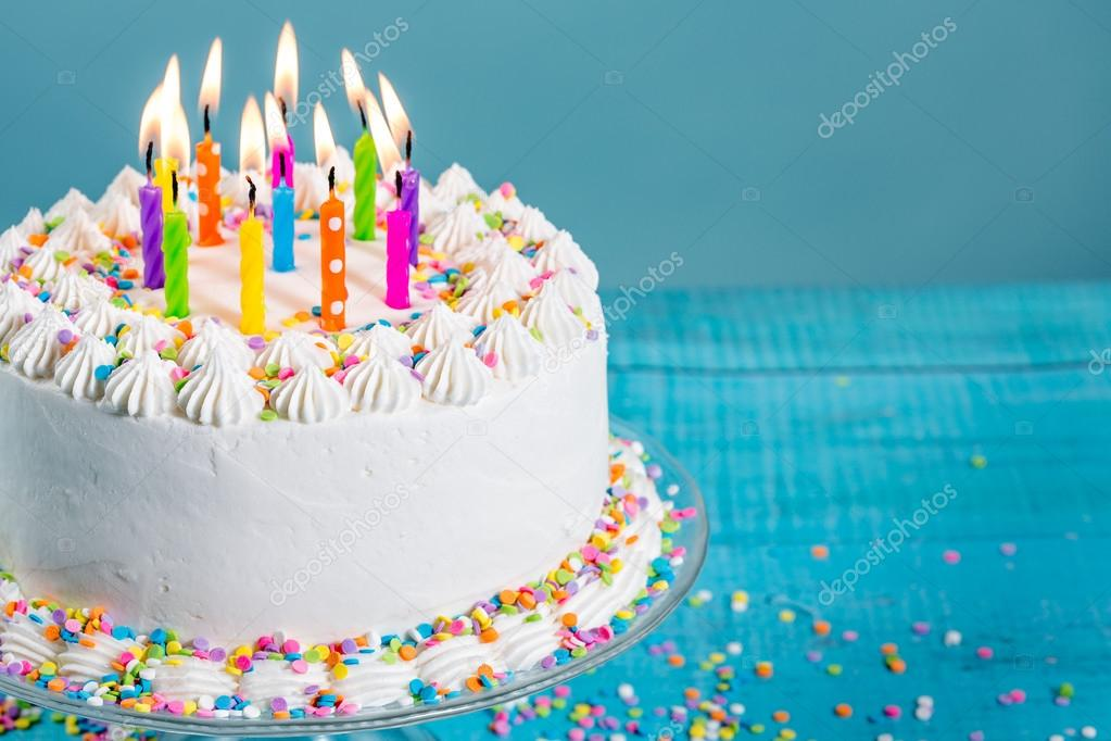 White Buttercream Icing Birthday Cake With Colorful Sprinkles And Candles Over Blue Background Photo By