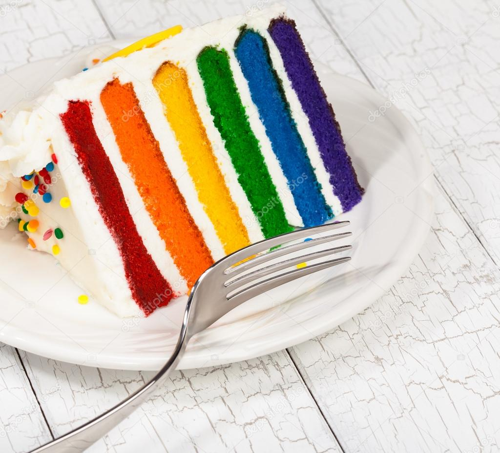 Slice Of Colourful Rainbow Layered Birthday Cake Stockfoto
