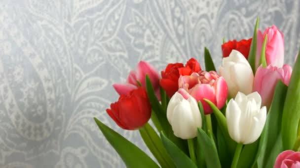 Beautiful delicate white and pink spring tulips. Delicate bouquet for a woman close up view