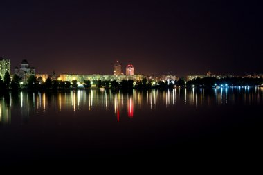 Lights night city with reflections on the river