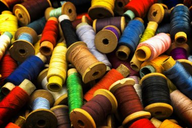 Colored high contrasted threads for sewing background