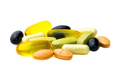 Mixed food supplement pills close-up, omega3, carotine, vitamins
