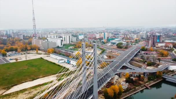 Ciurel passage, bridge over a river with moving cars, construction works near it. View from the drone. Bucharest, Romania