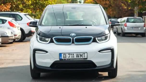 BUCHAREST, ROMANIA - OCTOBER 20, 2020: Modern BMW i3 electric car driving on the road. Close up view of the small zero emissions vehicle. Ecology idea