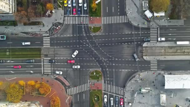 Crossroad with moving cars, bare trees and residential buildings, fog above the ground, view from a drone, Bucharest, Romania