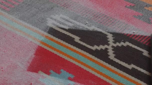 Hoovering multi-coloured carpet at home. Household and cleaning concept. Vacuum cleaner in house. Close-up. Point of view directly below