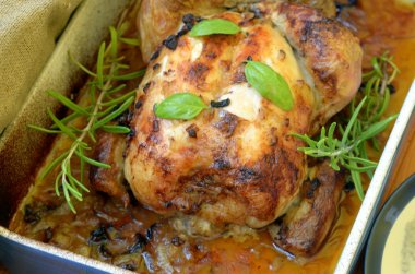 Roasted chicken with herbs and rice on wooden background
