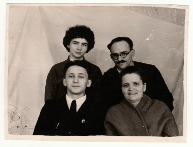 Vintage photo of family. Parents and their children.