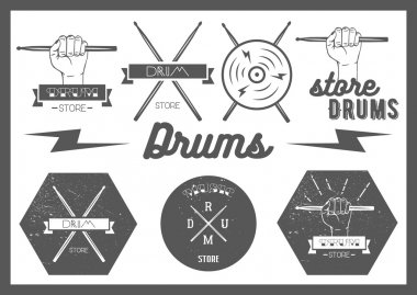 Vector set of vintage style drums labels, emblems and logo. Music design elements drum, drumsticks, hand, snare