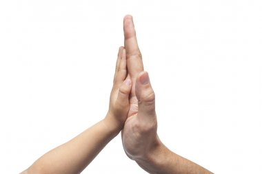 Father and son in high five gesture on white background