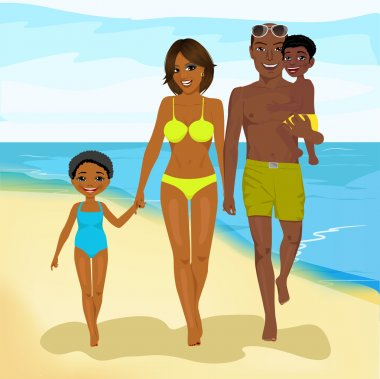 african american family walking happy along beach