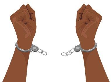hands of african american man breaking steel handcuffs