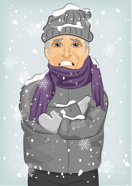 Senior man freezing in winter cold wearing woolen hat and jacket with scarf