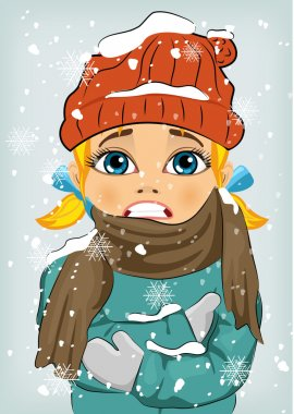 Little girl freezing in winter cold wearing woolen hat and jacket with scarf