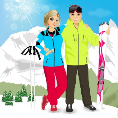 happy couple skiers standing on edge of mountain peaks