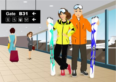 happy couple skiers standing in the hall of the airport