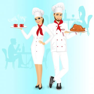 Attractive man and woman chefs